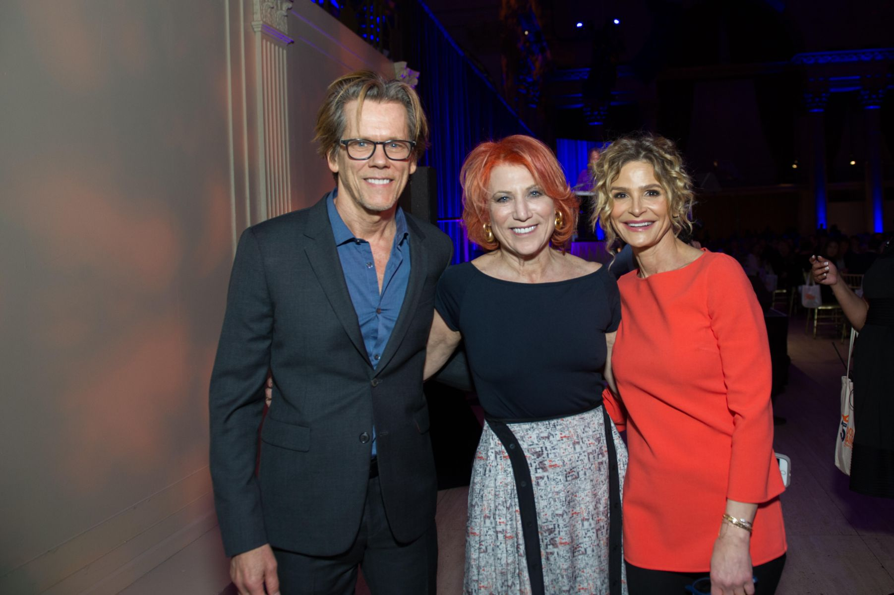 Famous actors Kevin Bacon and Kyra Sedgwick with event planner Marcy Blum at an event.
