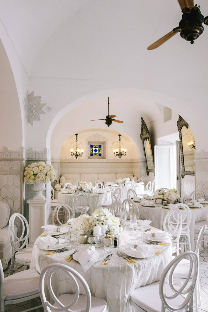 Midsummer Night's Eve-themed white welcome party at this Positano wedding weekend in Villa Tre Ville | Photo by Gianni di Natale