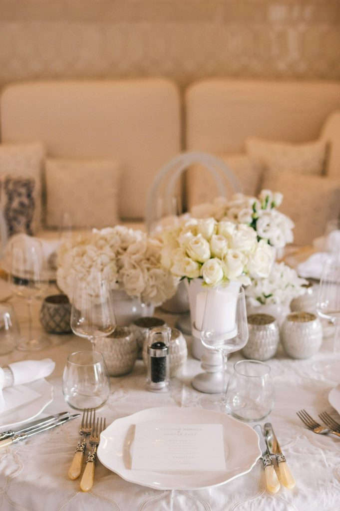 Table and floral decor at midsummer Night's Eve-themed white welcome party at this Positano wedding weekend in Villa Tre Ville | Photo by Gianni di Natale