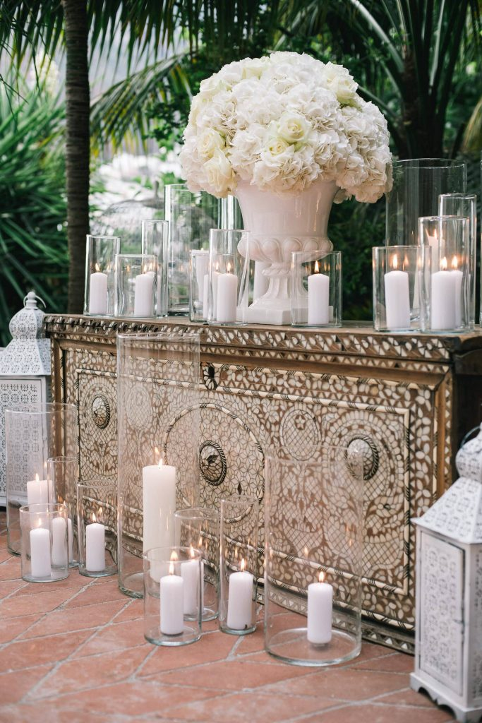 Floral decor for Midsummer Night's Eve-themed white welcome party at this Positano wedding weekend in Villa Tre Ville | Photo by Gianni di Natale