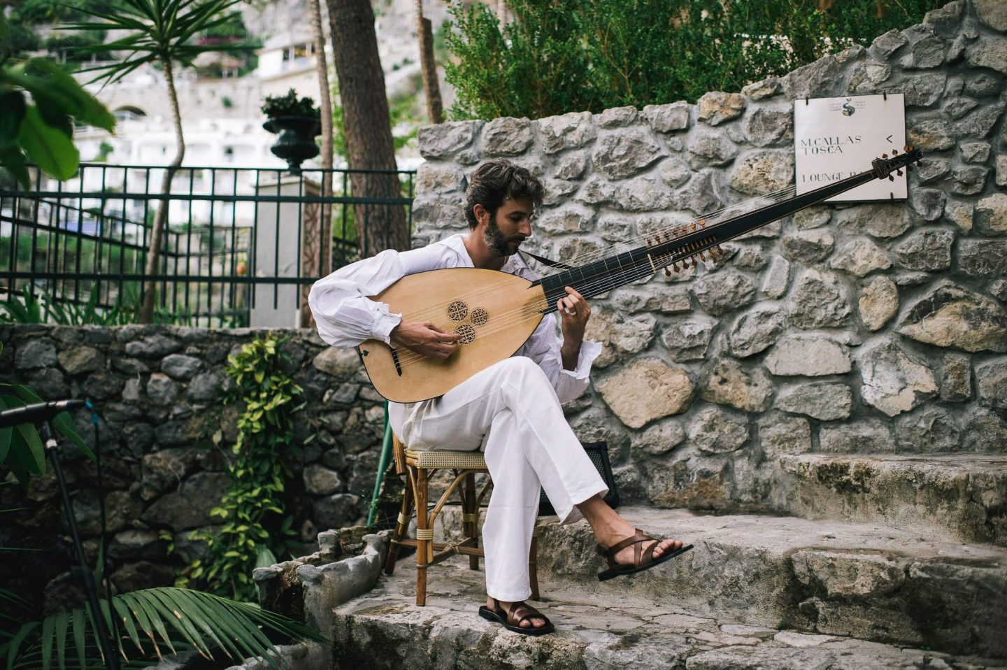 Entertainer for Midsummer Night's Eve-themed white welcome party at this Positano wedding weekend in Villa Tre Ville | Photo by Gianni di Natale