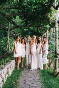 Bride with bridesmaids Midsummer Night's Eve-themed white welcome party at this Positano wedding weekend in Villa Tre Ville | Photo by Gianni di Natale