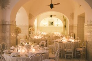 Table set-up for Midsummer Night's Eve-themed white welcome party at this Positano wedding weekend in Villa Tre Ville | Photo by Gianni di Natale