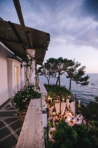 Nighttime at Midsummer Night's Eve-themed white welcome party at this Positano wedding weekend in Villa Tre Ville | Photo by Gianni di Natale