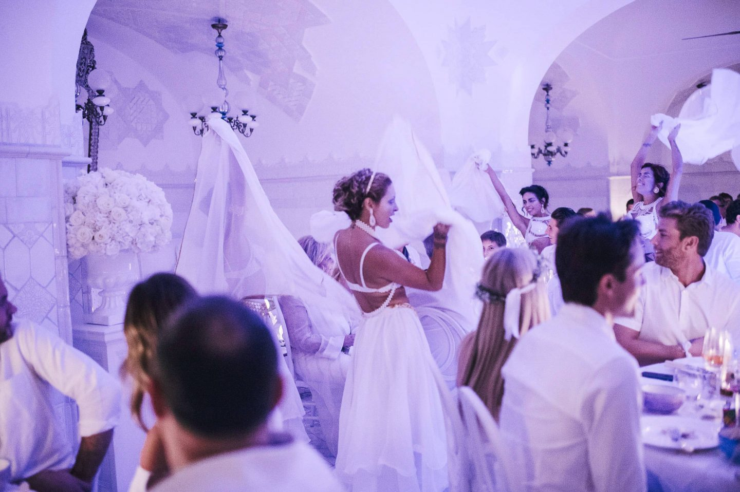 Entertainers at the Midsummer Night's Eve-themed white welcome party at this Positano wedding weekend in Villa Tre Ville | Photo by Gianni di Natale