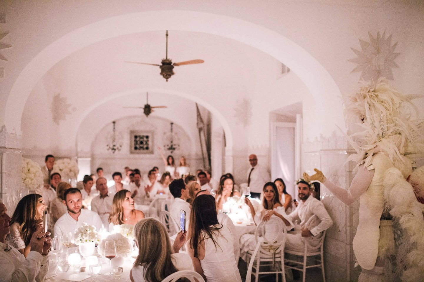 White feather surprise at the Midsummer Night's Eve-themed white welcome party at this Positano wedding weekend in Villa Tre Ville | Photo by Gianni di Natale
