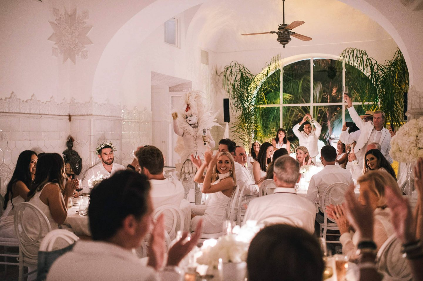 Guests at the Midsummer Night's Eve-themed white welcome party at this Positano wedding weekend in Villa Tre Ville | Photo by Gianni di Natale