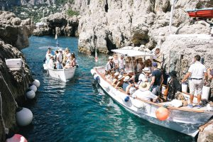 Guests on boats in Capri at this Positano wedding weekend in Villa Tre Ville | Photo by Gianni di Natale