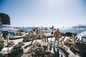Sunbathing at La Fontelina in Capri at this Positano wedding weekend in Villa Tre Ville | Photo by Gianni di Natale