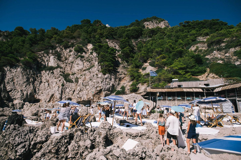 Sunbathing in La Fontelina in Capri at this Positano wedding weekend in Villa Tre Ville | Photo by Gianni di Natale