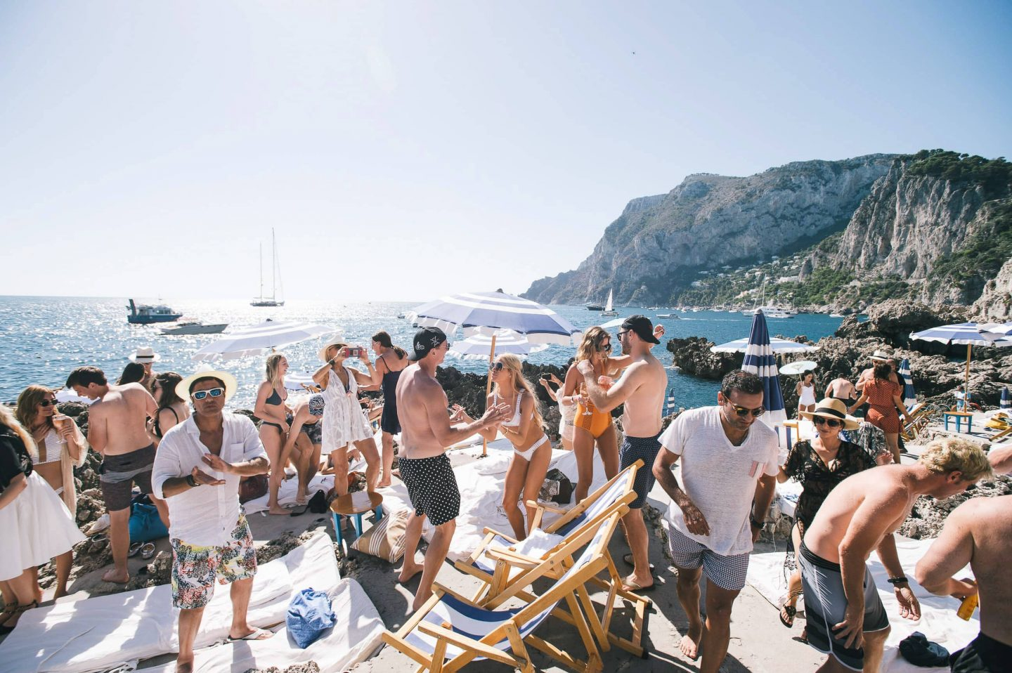 Guests outside at La Fontelina in Capri at this Positano wedding weekend in Villa Tre Ville | Photo by Gianni di Natale