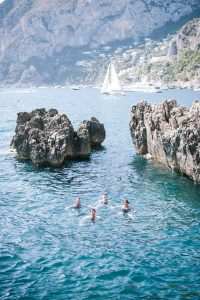 Swimming at La Fontelina in Capri at this Positano wedding weekend in Villa Tre Ville | Photo by Gianni di Natale