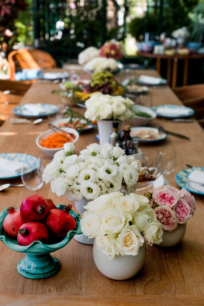 Floral and table decor at champagne bridesmaids brunch at this Positano wedding weekend in Villa Tre Ville | Photo by Gianni di Natale