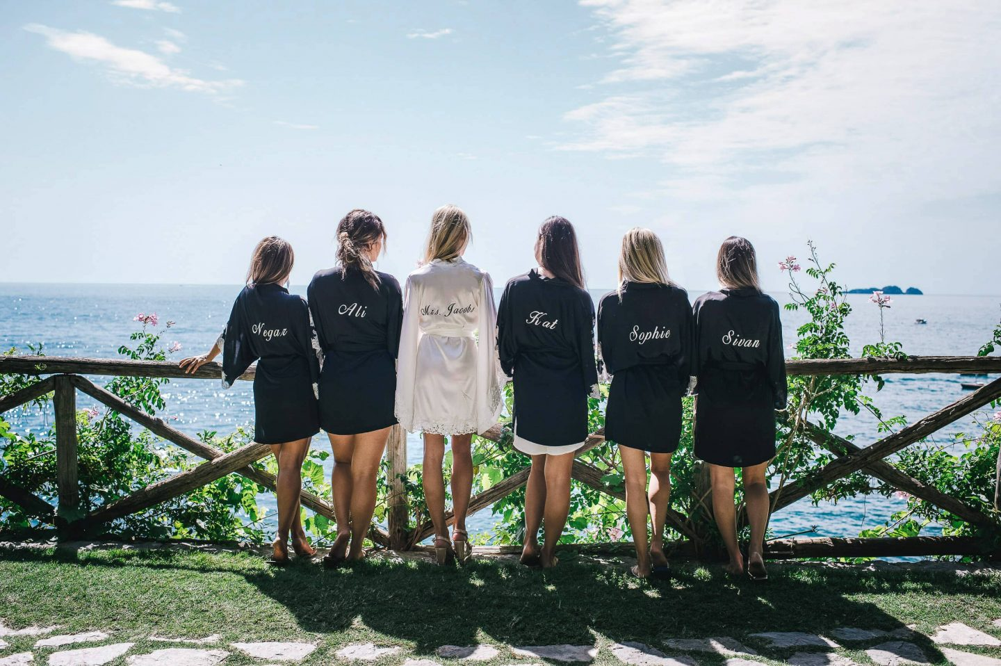 Bride and bridesmaids in robes at this Positano wedding weekend in Villa Tre Ville | Photo by Gianni di Natale