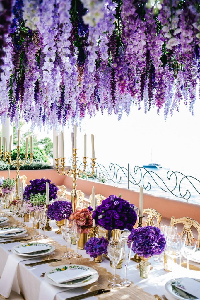 Hanging purple flower decor at this Positano wedding weekend in Villa Tre Ville | Photo by Gianni di Natale