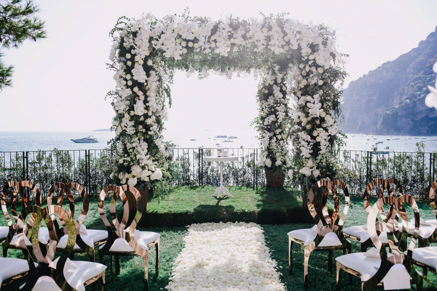 Floral arch during ceremony at this Positano wedding weekend in Villa Tre Ville | Photo by Gianni di Natale