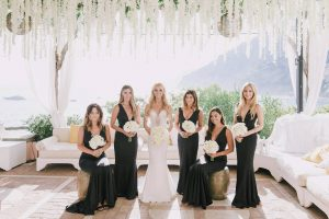Bride with bridesmaids in black at this Positano wedding weekend in Villa Tre Ville | Photo by Gianni di Natale