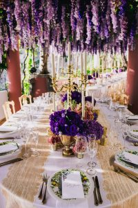Purple flower decoration at this Positano wedding weekend in Villa Tre Ville   Photo by Gianni di Natale