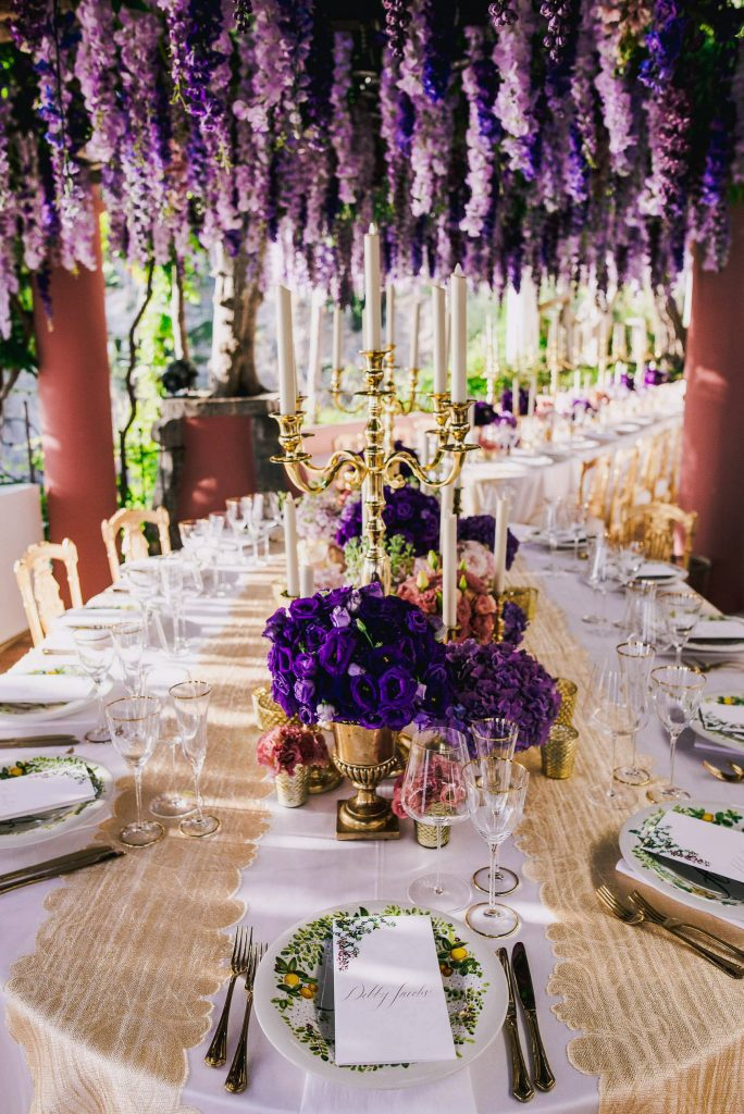 Purple flower decoration at this Positano wedding weekend in Villa Tre Ville | Photo by Gianni di Natale