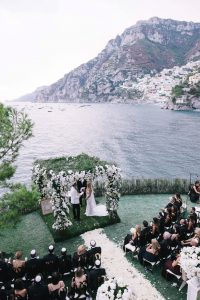 Bride and groom at outdoor ceremony at this Positano wedding weekend in Villa Tre Ville | Photo by Gianni di Natale