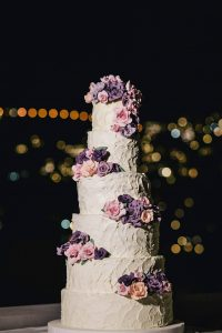 6-tier wedding cake with purple flower design at this Positano wedding weekend in Villa Tre Ville | Photo by Gianni di Natale
