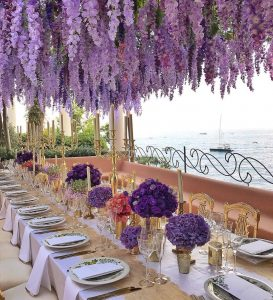 Purple flower decor for reception at this Positano wedding weekend in Villa Tre Ville | Photo by Gianni di Natale