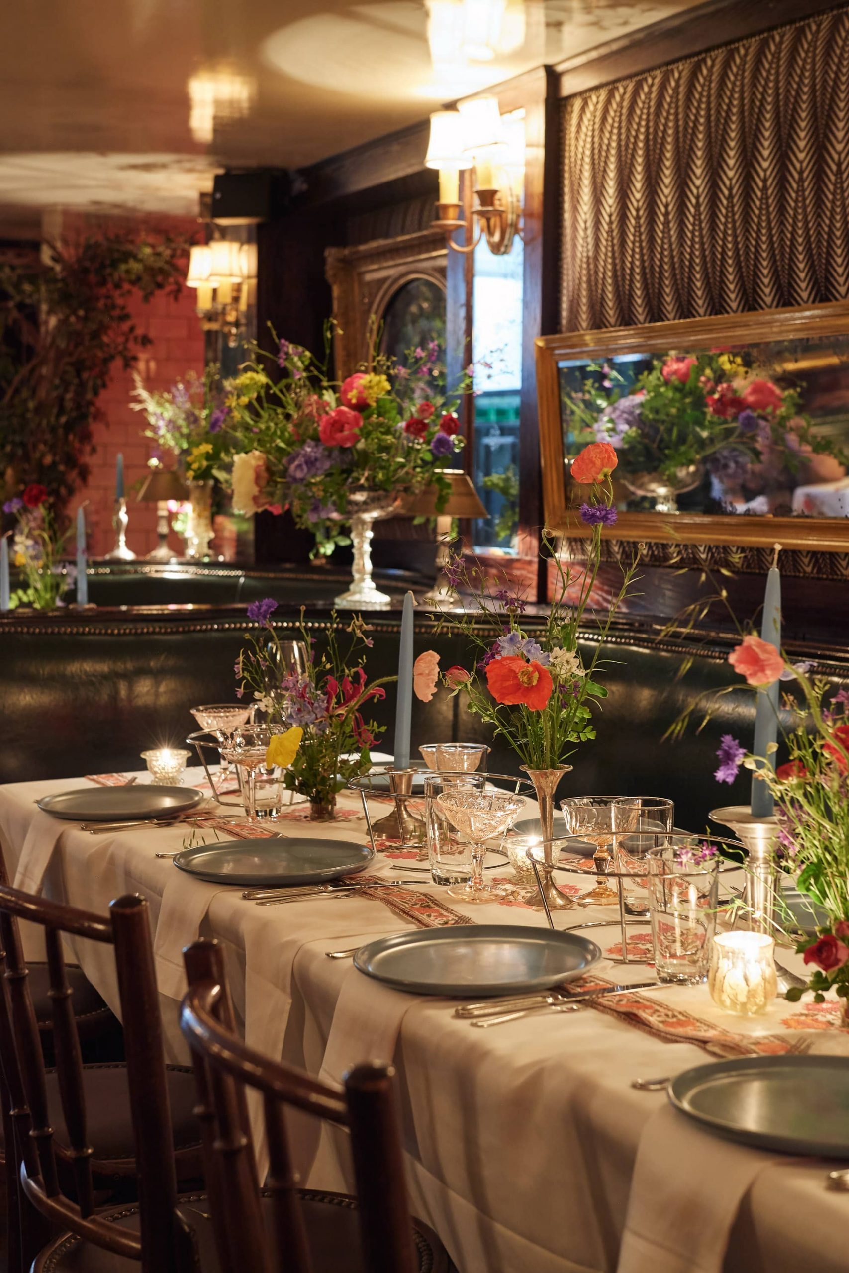 Table and floral decor at this 40th surprise birthday party at Beatrice Inn in West Village | Photo by Darren Ornitz