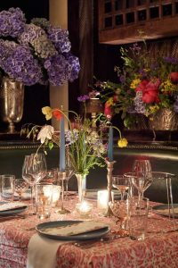 Floral and table decor at this 40th surprise birthday party at Beatrice Inn in West Village | Photo by Darren Ornitz
