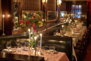 Booth seating at this 40th surprise birthday party at Beatrice Inn in West Village | Photo by Darren Ornitz