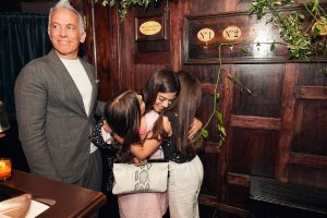 Hugs at this 40th surprise birthday party at Beatrice Inn in West Village | Photo by Darren Ornitz