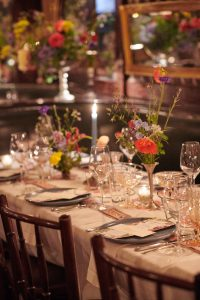 Warm tablescape at this 40th surprise birthday party at Beatrice Inn in West Village | Photo by Darren Ornitz