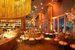 Red and gold decor at this 40th surprise birthday at the Boom Boom Room in NYC   Photo by Luis Zepeda
