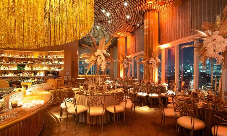 Red and gold decor at this 40th surprise birthday at the Boom Boom Room in NYC | Photo by Luis Zepeda