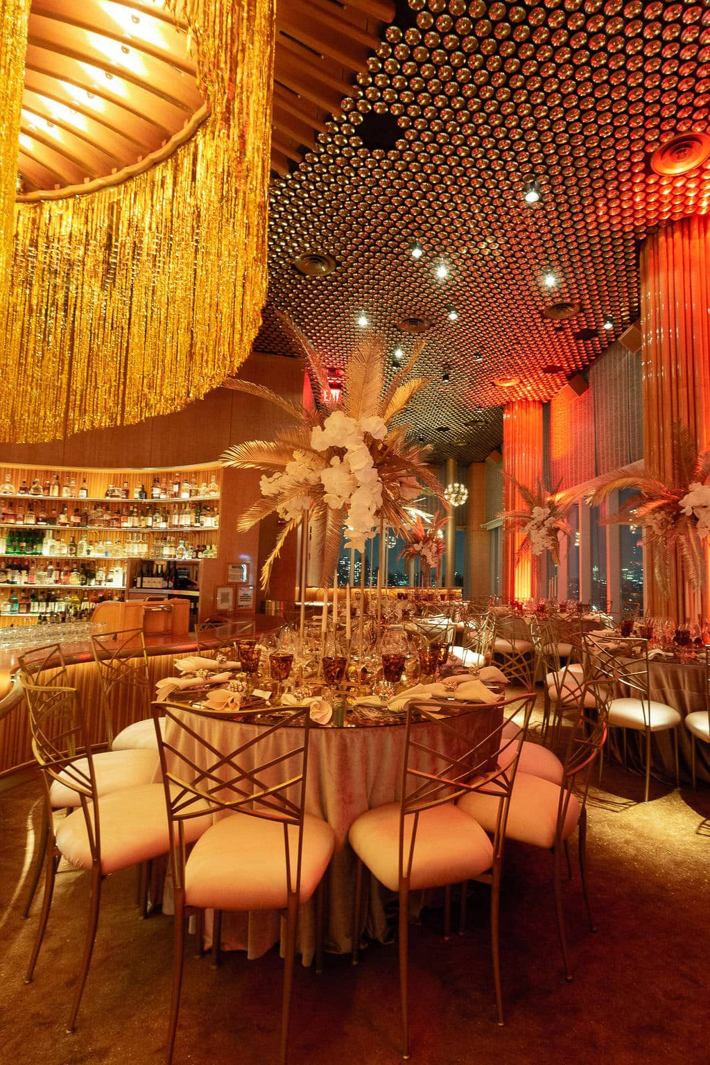 Gorgeous red and gold decor at this 40th surprise birthday at the Boom Boom Room in NYC | Photo by Luis Zepeda