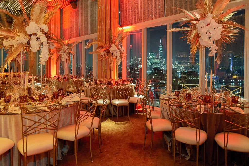 Glamorous red and gold decor at this 40th surprise birthday at the Boom Boom Room in NYC | Photo by Luis Zepeda