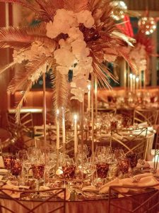 Gold and red table decor at this 40th surprise birthday at the Boom Boom Room in NYC | Photo by Luis Zepeda