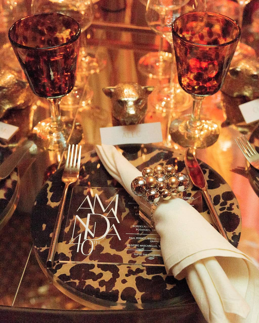 Glamorous table setting at this 40th surprise birthday at the Boom Boom Room in NYC | Photo by Luis Zepeda