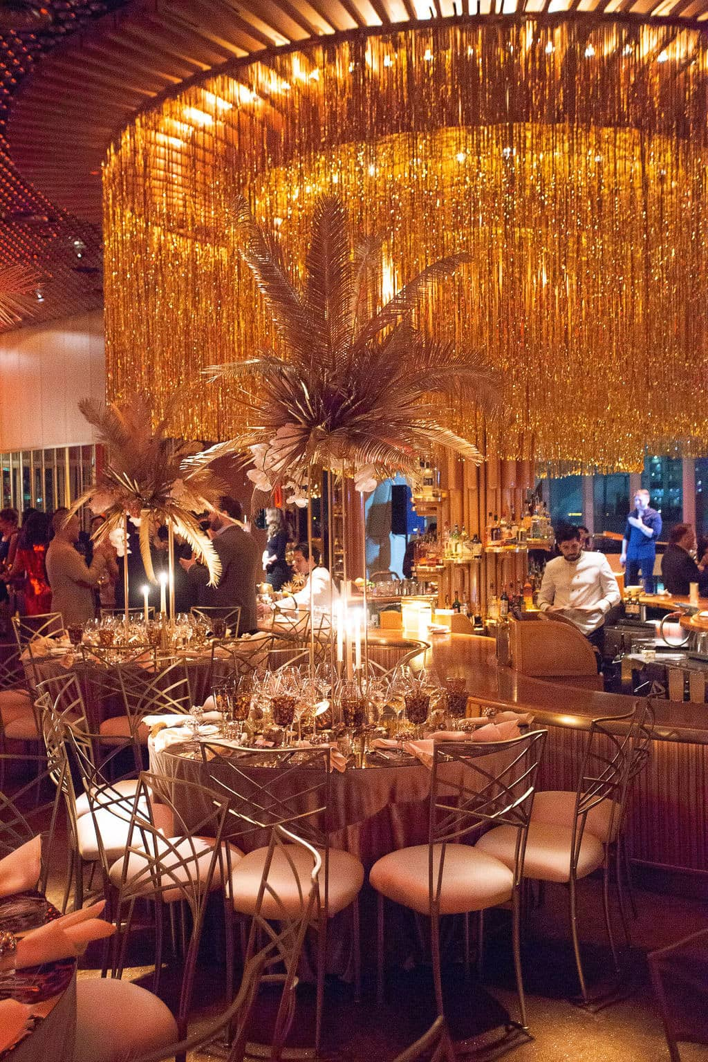Glamorous gold decor at this 40th surprise birthday at the Boom Boom Room in NYC | Photo by Luis Zepeda