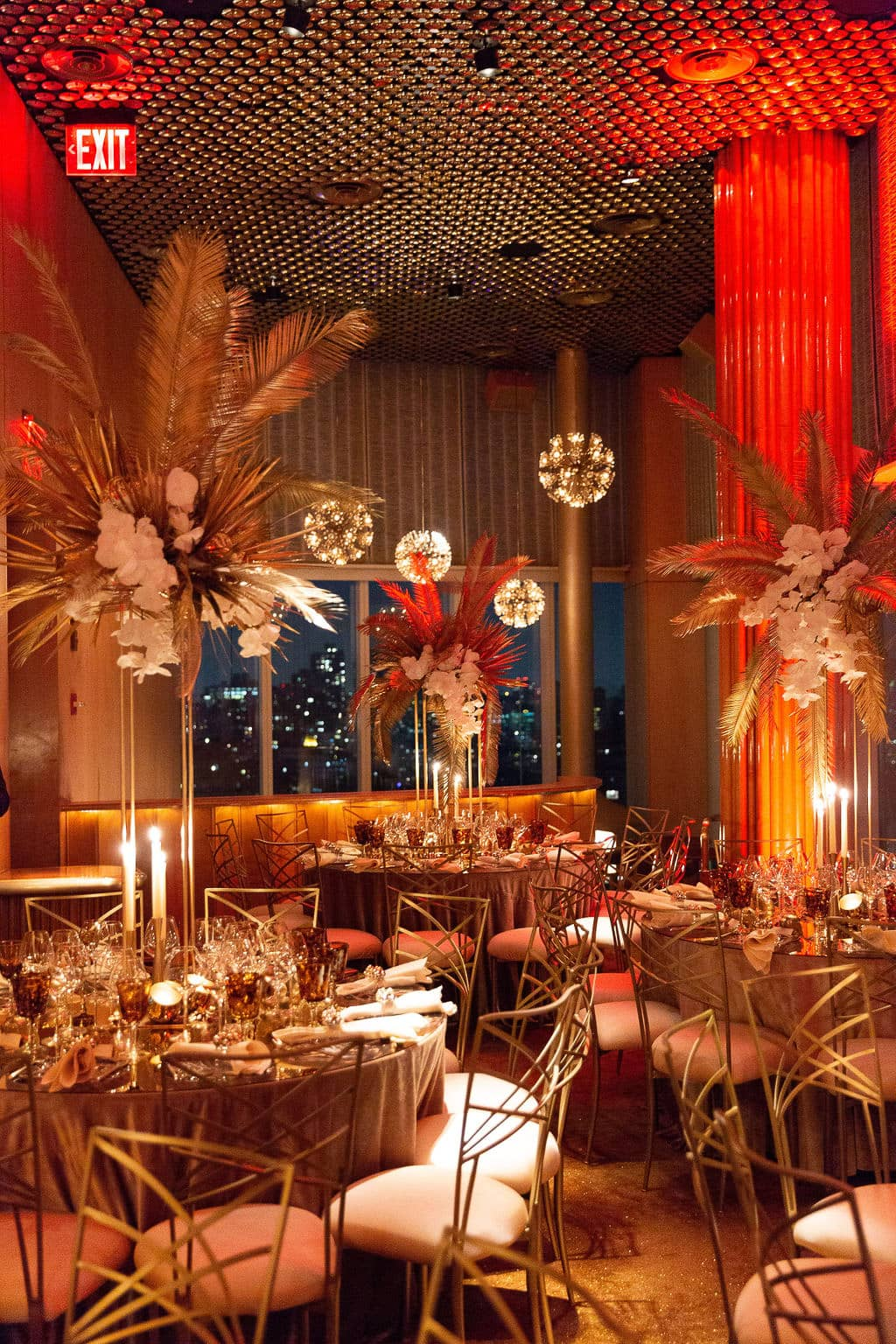 Red and gold glamorous decor at this 40th surprise birthday at the Boom Boom Room in NYC | Photo by Luis Zepeda