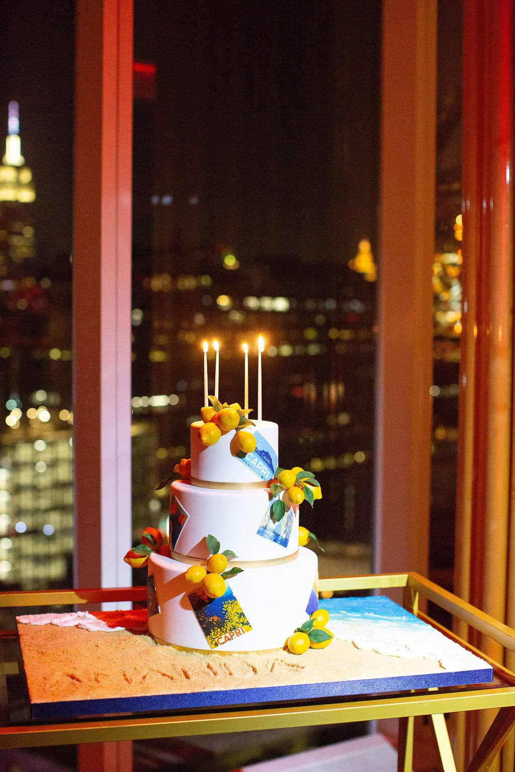 3-tier Capri-inspired birthday cake with lemon details at this 40th surprise birthday at the Boom Boom Room in NYC | Photo by Luis Zepeda