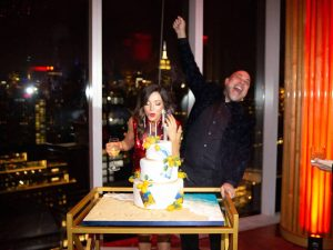Blowing out the candles at this 40th surprise birthday at the Boom Boom Room in NYC | Photo by Luis Zepeda