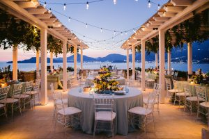 Table decor for a 60s-themed welcome party at this Aman Sveti Stefan Montenegro destination wedding weekend | Photo by Allan Zepeda