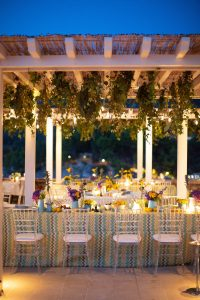 Decor for a 60s-themed welcome party at this Aman Sveti Stefan Montenegro destination wedding weekend | Photo by Allan Zepeda