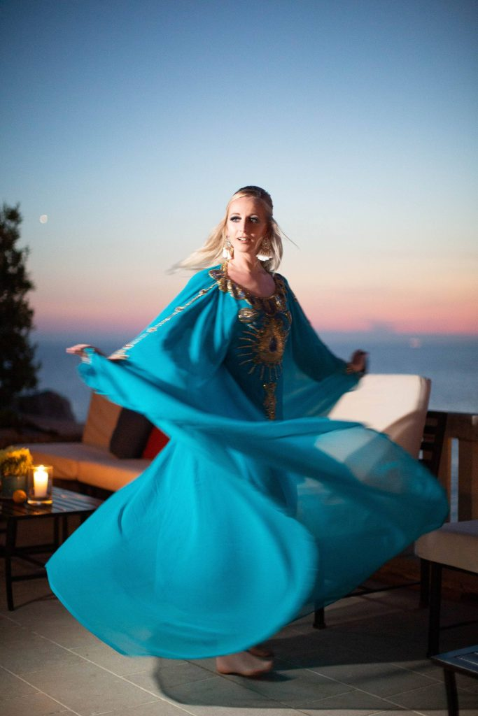 Blue caftan outfit at 60s-themed welcome party at this Aman Sveti Stefan Montenegro destination wedding weekend | Photo by Allan Zepeda