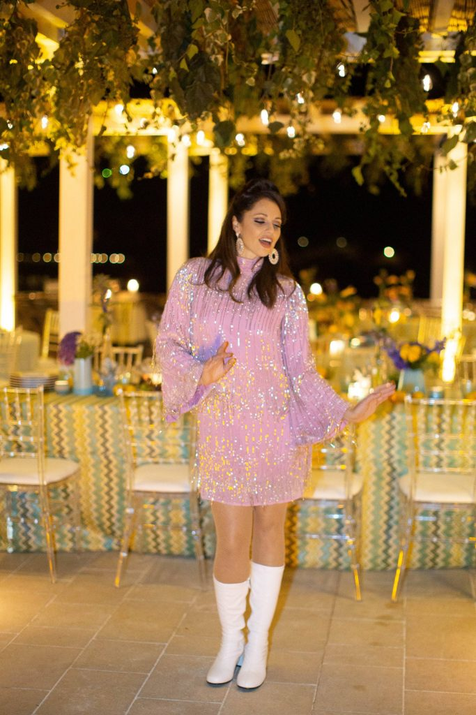 Pinkish-purple mini dress at 60s-themed welcome party at this Aman Sveti Stefan Montenegro destination wedding weekend | Photo by Allan Zepeda