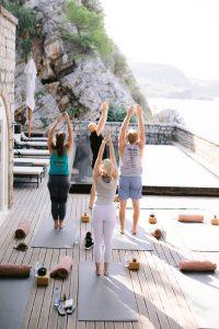 Yoga overlooking the sea at this Aman Sveti Stefan Montenegro destination wedding weekend | Photo by Allan Zepeda