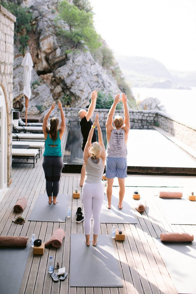 Yoga overlooking the sea at this Aman Sveti Stefan Montenegro destination wedding weekend | Photo by Allan Zepeda