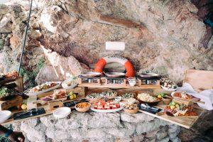 Private beach BBQ set-up at this Aman Sveti Stefan Montenegro destination wedding weekend | Photo by Allan Zepeda