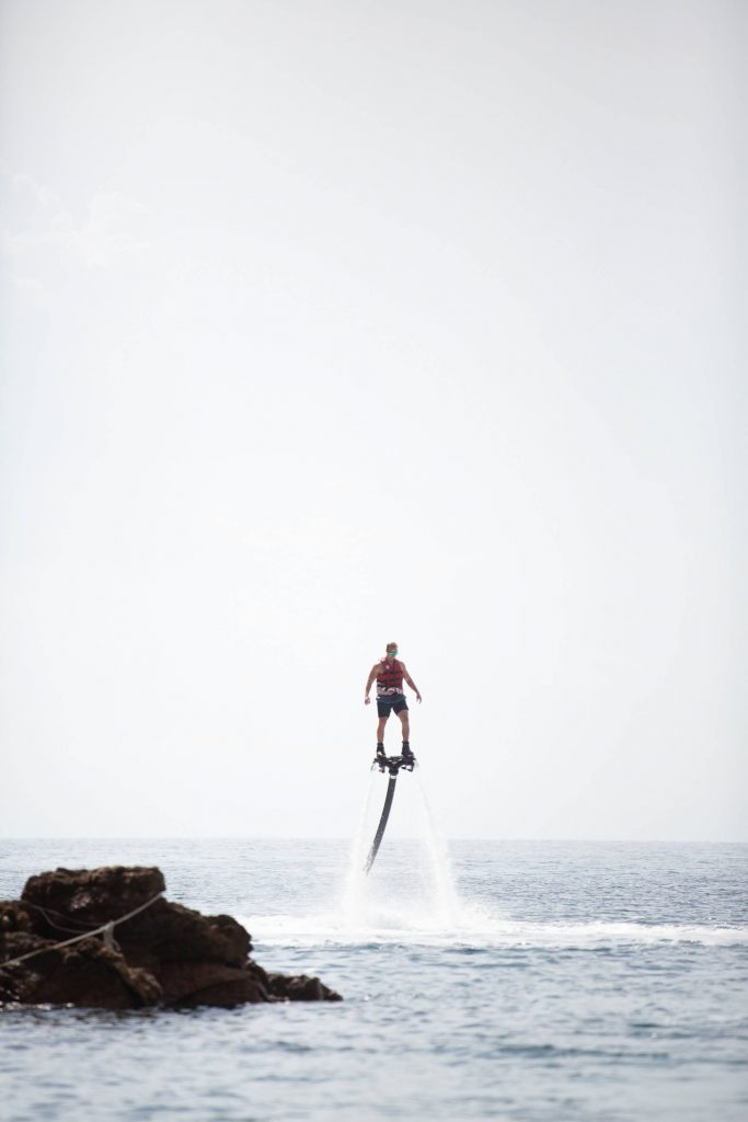 Water flyboard from private beach at this Aman Sveti Stefan Montenegro destination wedding weekend | Photo by Allan Zepeda