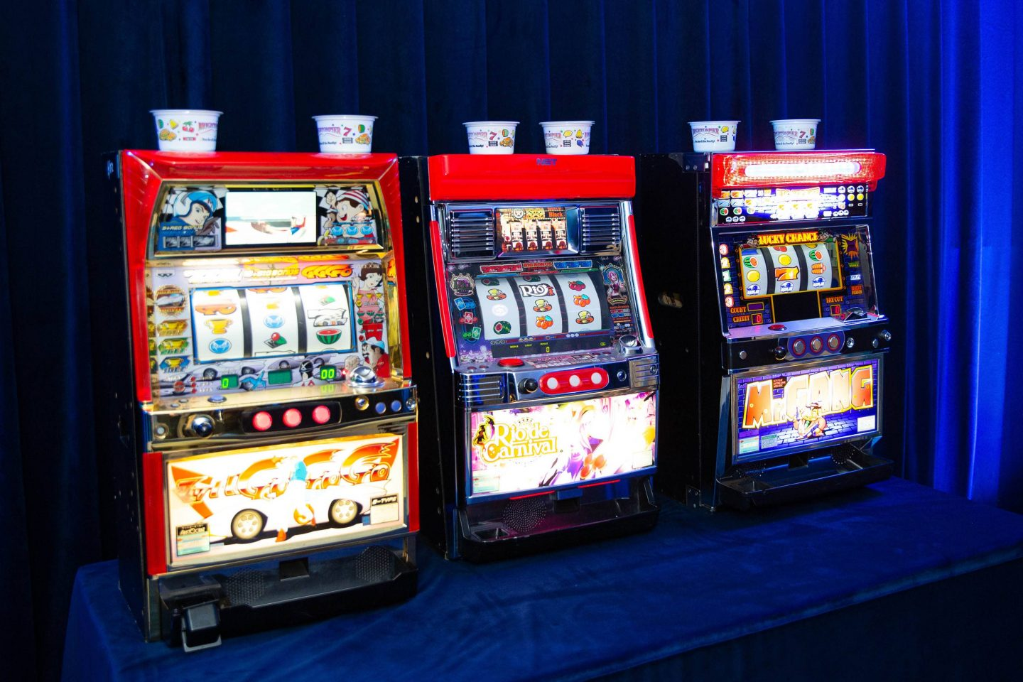 Slot machines at Casino Royale-themed party at this Aman Sveti Stefan Montenegro destination wedding weekend | Photo by Allan Zepeda